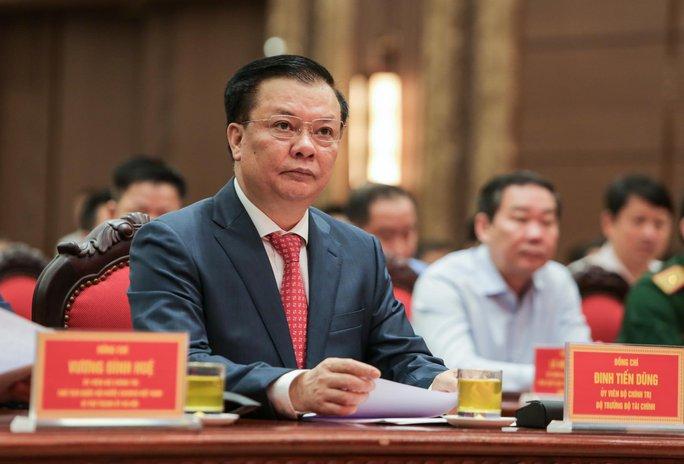 Công bố quyết định của Bộ Chính trị phân công ông Đinh Tiến Dũng làm Bí thư Thành ủy Hà Nội - Ảnh 7.