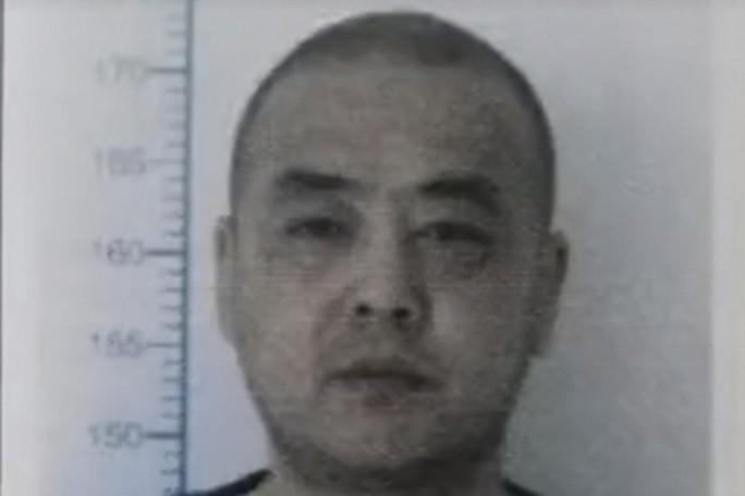 Trung Quốc: Chấn động vụ kẻ sát nhân được thăng chức - Ảnh 1.
