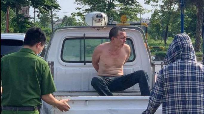Khởi tố kẻ truy nã đặc biệt nguy hiểm tấn công tài xế taxi - Ảnh 1.