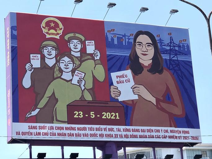 Đường phố rực cờ hoa, hơn 1,1 triệu cử tri Quảng Nam sẵn sàng đi bầu cử - Ảnh 1.