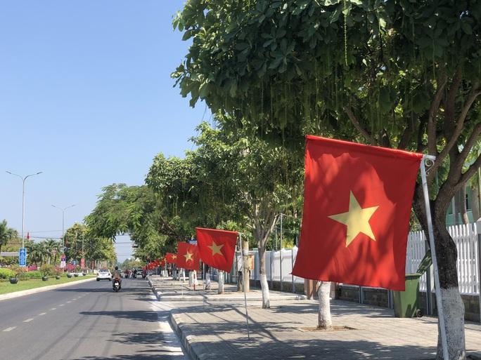 Đường phố rực cờ hoa, hơn 1,1 triệu cử tri Quảng Nam sẵn sàng đi bầu cử - Ảnh 19.