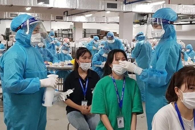 Đề xuất hỗ trợ 80.000 đồng/ngày cho người lao động khi cách ly phòng dịch Covid-19 - Ảnh 2.