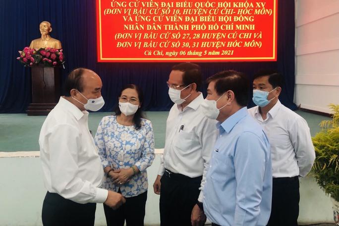 Chủ tịch nước Nguyễn Xuân Phúc: Củ Chi và Hóc Môn có nhiều tiềm năng phát triển - Ảnh 1.