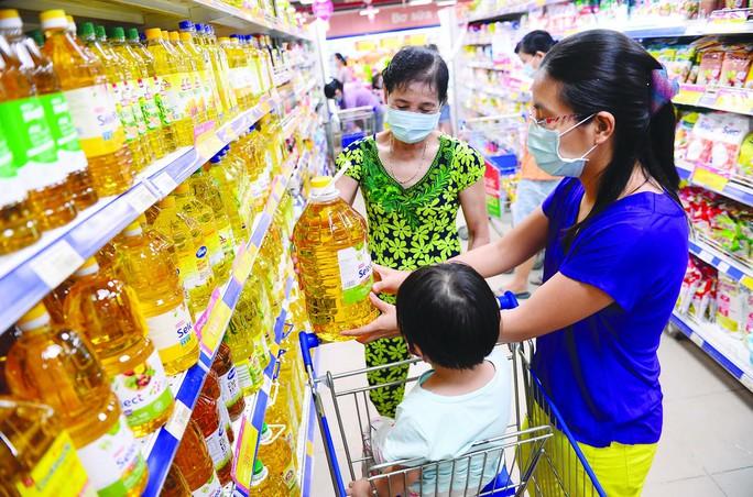 Co.opXtra, Co.opmart, Co.op Food giảm giá 10.000 sản phẩm thiết yếu - Ảnh 1.