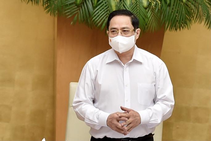 Thủ tướng Phạm Minh Chính: Xử lý nghiêm, kể cả xử lý hình sự việc lơ là chống dịch Covid-19 - Ảnh 1.