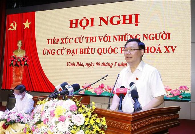 Chủ tịch Quốc hội Vương Đình Huệ: Nếu ngồi phòng lạnh để làm luật sẽ không sát thực - Ảnh 1.