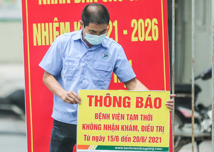 CLIP: Bệnh viện Đức Giang ngừng nhận bệnh nhân sau ca dương tính SARS-CoV-2 mới - Ảnh 2.