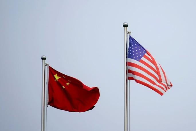 Bộ Thương mại Mỹ bị phê bình nhìn Trung Quốc thâu tóm công nghệ - Ảnh 1.