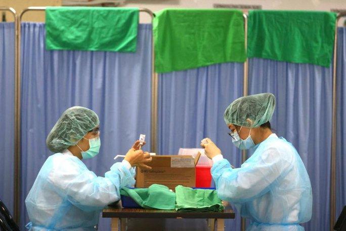Bất chấp Trung Quốc, Nhật Bản gửi vắc-xin Covid-19 cho Đài Loan  - Ảnh 1.