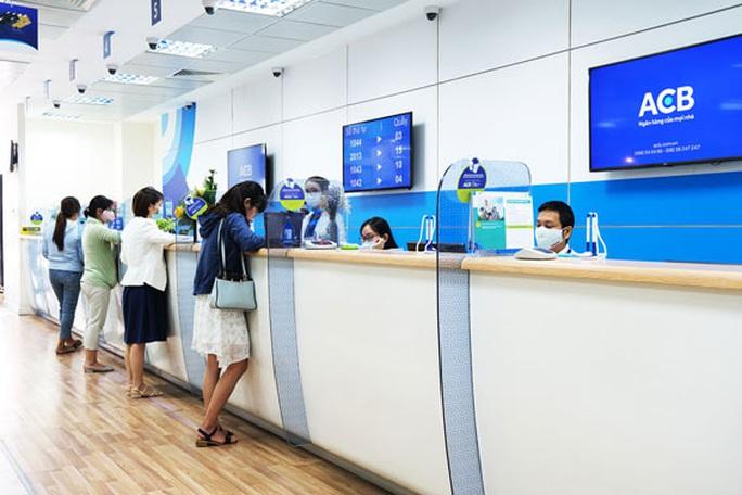 Những ngân hàng đầu tiên công bố giảm lãi suất cho vay - Ảnh 1.