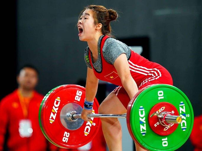 Nữ lực sĩ dân tộc Giáy mơ huy chương Olympic - Ảnh 1.