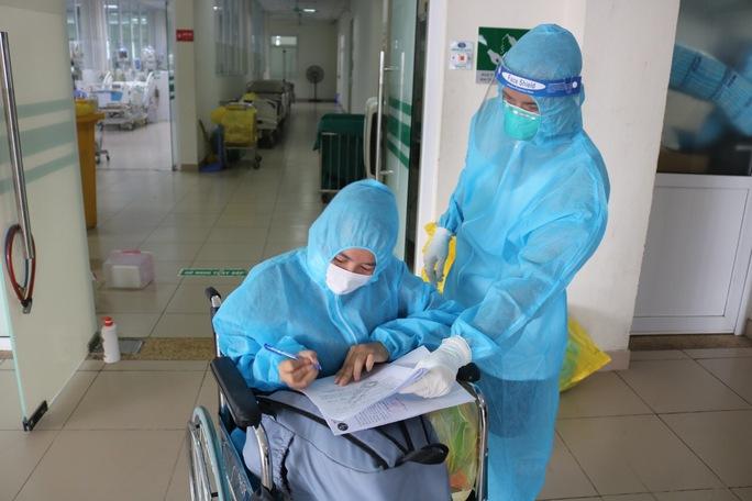 Hơn 7.200 bệnh nhân Covid-19 đã được xuất viện - Ảnh 1.