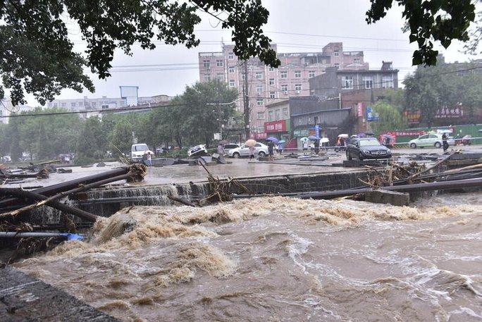 Trung Quốc dự báo đúng mưa lũ nhưng... sai thời gian và địa điểm - Ảnh 5.