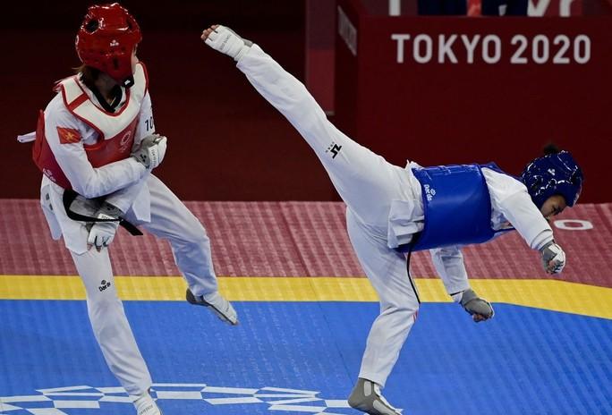 Olympic Tokyo ngày 24-7: Văn Đương hạ võ sĩ hạng 9 thế giới - Ảnh 7.