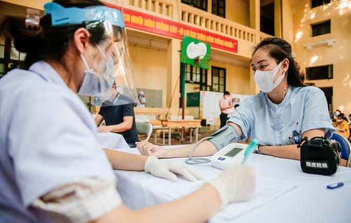 CLIP: Hà Nội bắt đầu tiêm vắc-xin Covid-19 diện rộng cho người dân - Ảnh 14.