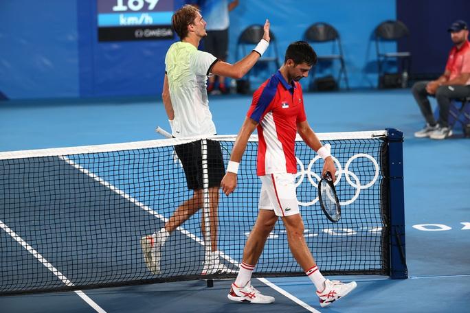 Djokovic mất danh hiệu Golden Slam sau thất bại ở Olympic Tokyo 2020 - Ảnh 4.