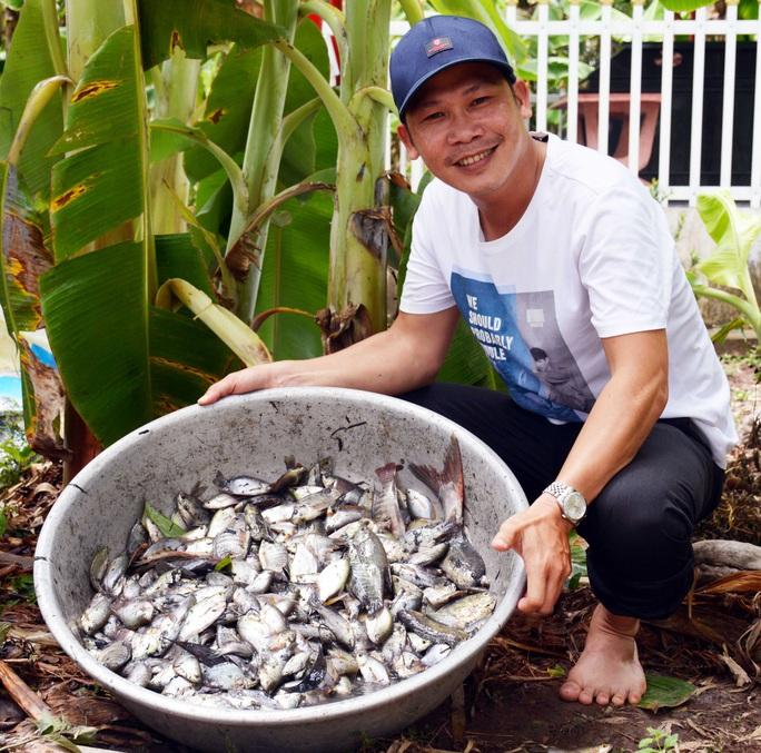 Chùm ảnh: Hấp dẫn tát đìa bắt cá đồng nướng rơm ở miền Tây - Ảnh 6.