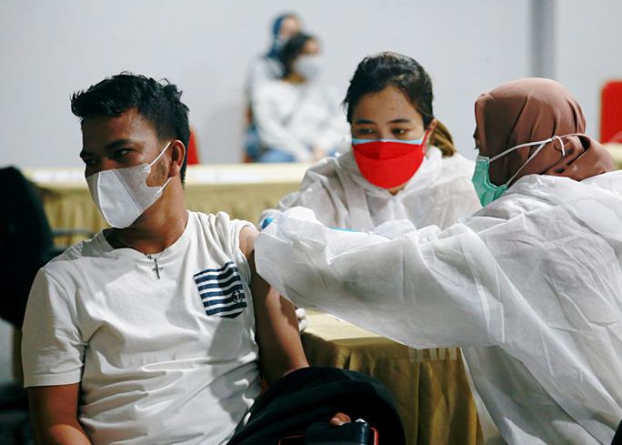 Nhật Bản tiếp tục san sẻ vắc-xin Covid-19 cho châu Á - Ảnh 1.
