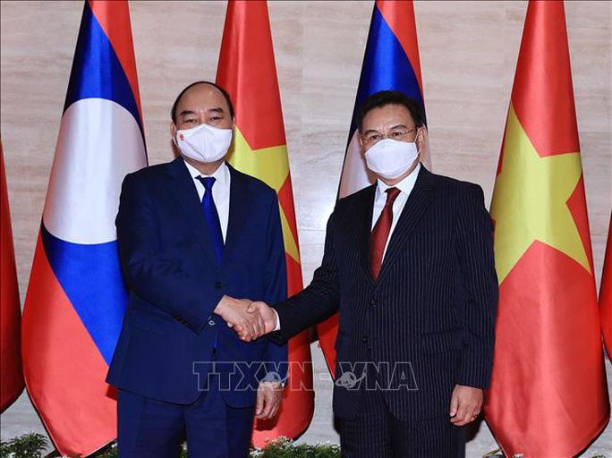 Chủ tịch nước Nguyễn Xuân Phúc phát biểu tại Kỳ họp Quốc hội Lào - Ảnh 3.