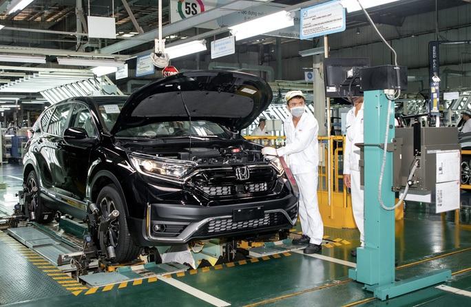 Phó Thủ tướng chỉ đạo sau khi có đề xuất tiếp tục giảm 50% lệ phí trước bạ ôtô - Ảnh 1.