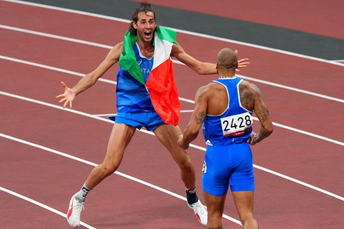 Chia sẻ HCV, 2 nhà vô địch nhảy cao khiến thế giới ngả mũ thán phục - Ảnh 7.