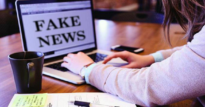 Nhiều chủ tài khoản Facebook bị phạt vì chia sẻ thông tin sai sự thật về dịch Covid-19 - Ảnh 1.