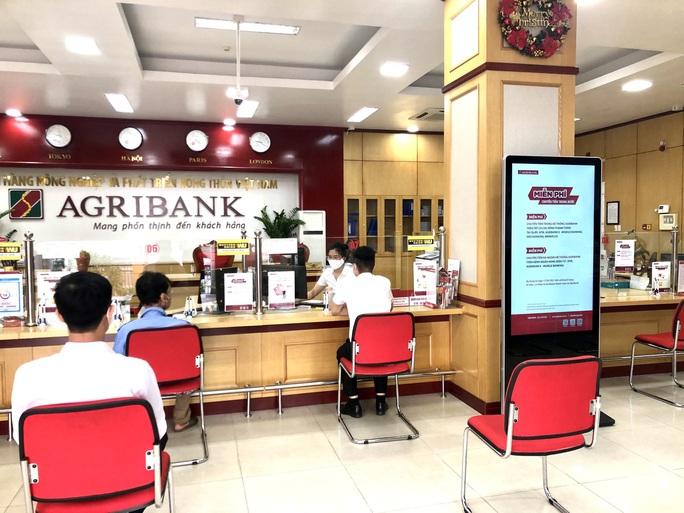 Agribank giải ngân hơn 116.000 tỉ đồng và 122 triệu USD - Ảnh 1.