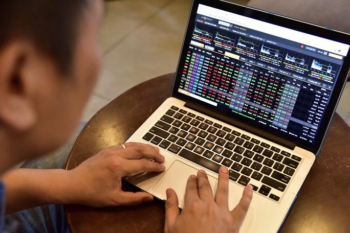 Chứng khoán ngày mai 27-8: Cổ phiếu ngân hàng sẽ tăng giá trở lại? - Ảnh 1.