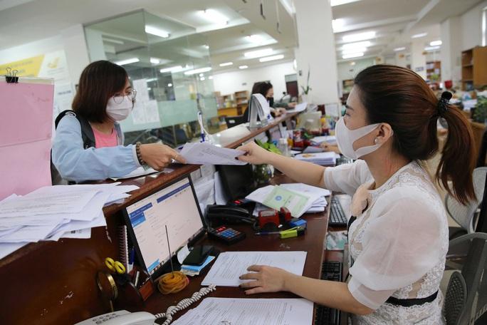 Bảo hiểm xã hội Thành phố Hồ Chí Minh đồng hành cùng người lao động - Ảnh 1.