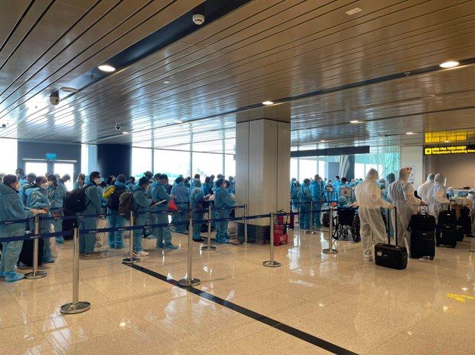 Hai chuyến bay thí điểm hộ chiếu vắc-xin với công dân từ Mỹ về nước - Ảnh 11.