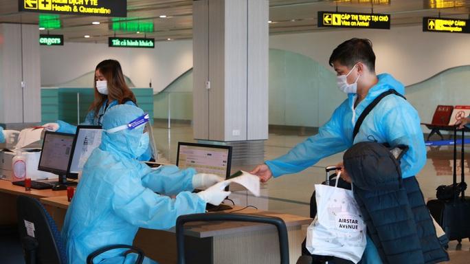Hai chuyến bay thí điểm hộ chiếu vắc-xin với công dân từ Mỹ về nước - Ảnh 13.