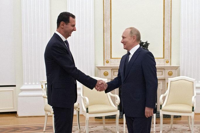 Covid-19: Tổng thống Putin tự cách ly - Ảnh 1.
