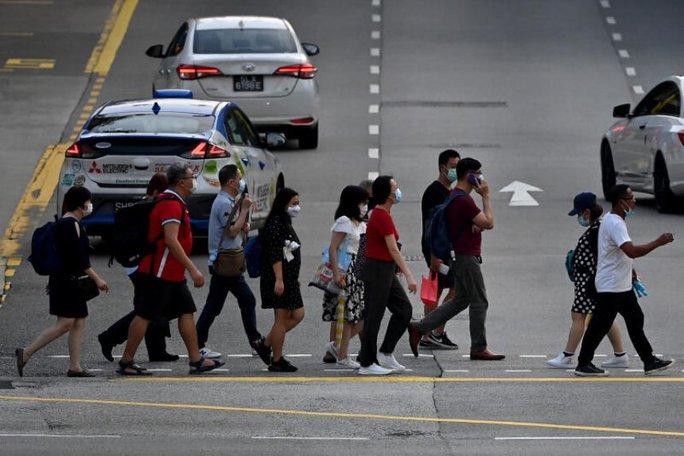 Covid-19: Số ca mắc mới ở Singapore tăng dựng đứng - Ảnh 1.