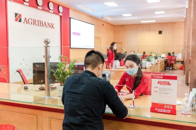 Nhiều ngân hàng miễn 100% phí dịch vụ thanh toán - Ảnh 1.