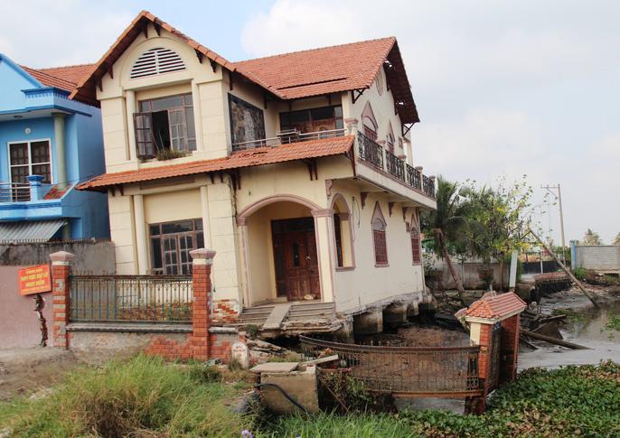 Kinh hãi 27 căn nhà sắp tuột xuống sông Sài Gòn! - Ảnh 7.
