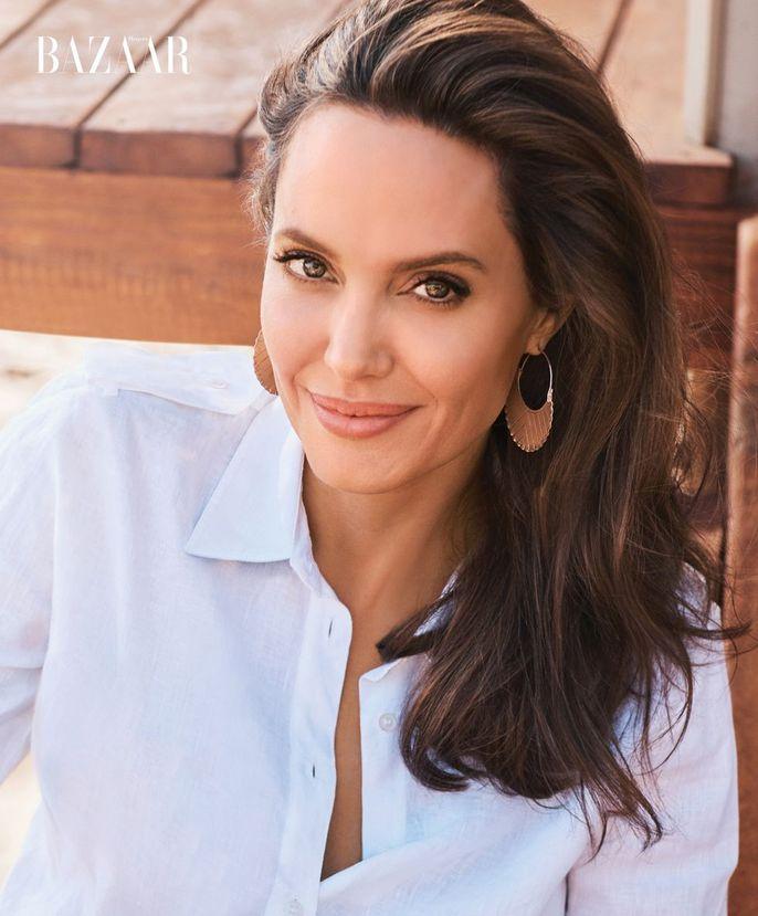 Angelina Jolie đẹp cùng báo đốm - Ảnh 4.