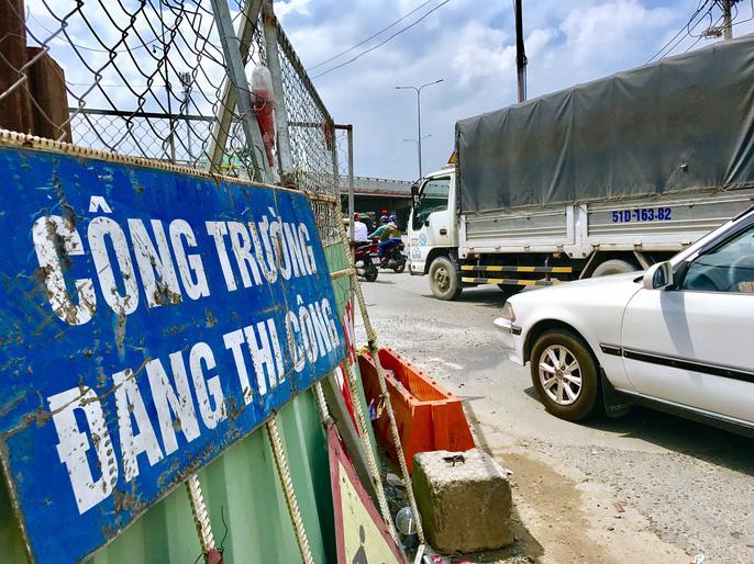 Cận cảnh những công trình mở lối giao thông tại TP HCM - Ảnh 8.