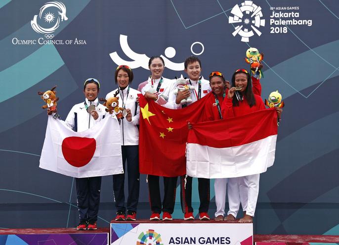 Bỏng mắt xem các nữ VĐV bóng chuyền bãi biển ASIAD - Ảnh 1.