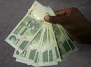 """Chán tiền tỉ đô, Zimbabwe phát hành """"phiên bản USD"""""""