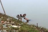 Đang thả lưới, hốt hoảng vớt được xác chết trôi sông