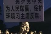 Trung Quốc: Người biểu tình đốt xe cảnh sát, 39 người bị thương