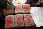 Bắt quả tang 2 người Lào vận chuyện 20 bánh heroin