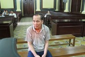 Bị bắt sau 20 năm tạt axit, giết vợ