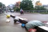 Lén vứt rác trên cầu