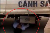 Bị giữ xe, nam thanh niên chui vào gầm ô tô CSGT