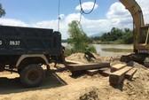 Trục vớt 16 phách gỗ lậu bị lâm tặc phi tang