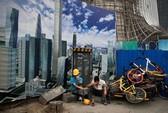 Kinh tế toàn cầu tụt bậc vì Mỹ - Trung
