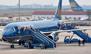 Tội phạm còng tay dẫn độ dọa có bom trên máy bay Vietnam Airlines