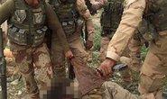 Binh sĩ Iraq hành hạ xác tù nhân IS