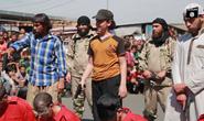 Nụ cười rợn người của cậu bé hành quyết tù nhân giúp IS